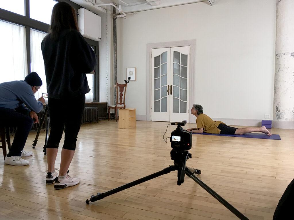 Crew filming yoga demonstration